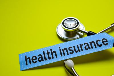 closeup health insurance with stethoscope concept inspiration on yellow background
