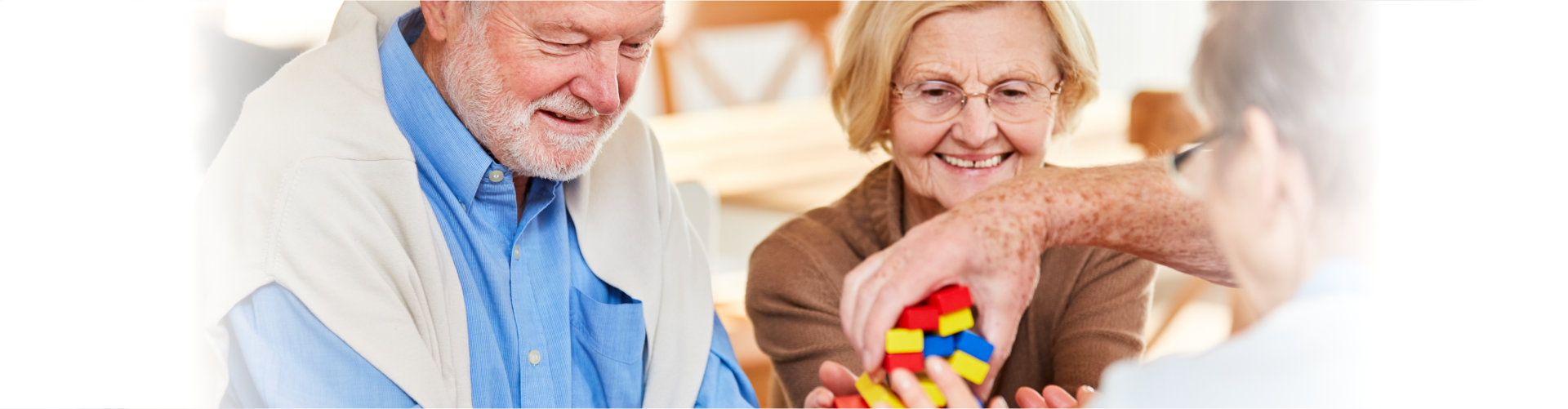 group of elderly stacking the building blocks